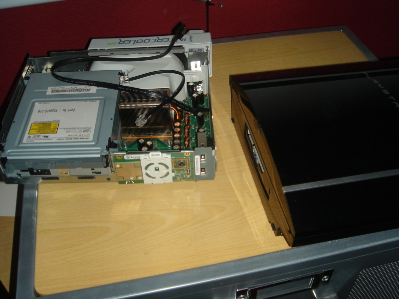 Fitting an Xbox 360 into a PS3 case just may make your eyes bleed