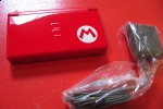 Nintendo DS New Super Mario Bros bundle gets unboxed: it's red