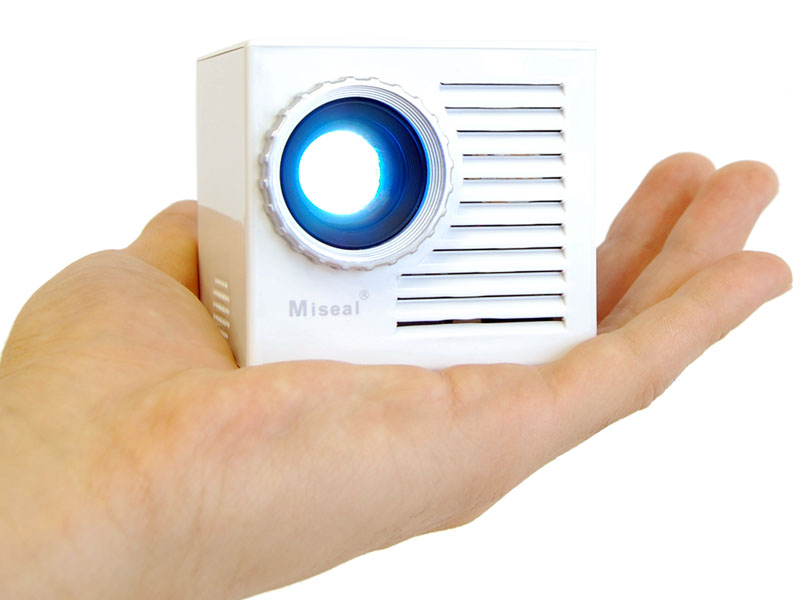 Unique miniature cube projector with docking speaker