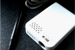 BeamBox Essential G2 pico-projector aimed at netbooks/notebooks