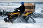 Plasma HDTV gets snow-quad courier in iced-up UK