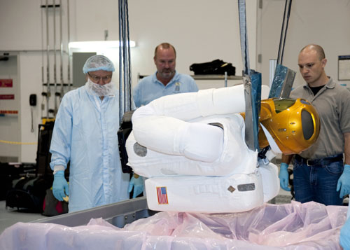 Robonaut 2 gets packed away into a case for trip to ISS