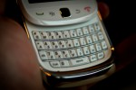Hands on the White BlackBerry Torch