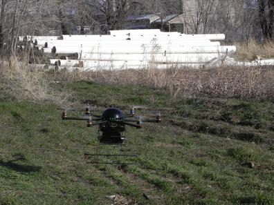 Hexacopter Senses Motion and Breathing Through Concrete Walls
