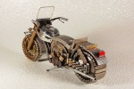 Geek makes toy motorcycles out of watch parts