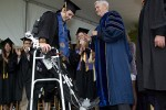 Robotic Exoskeleton Helps Paraplegic Student Walk