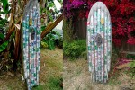 Artist makes surfboard out of 72 beer cans