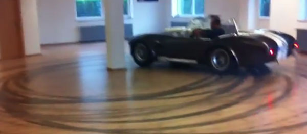 Dude does donuts in tiny room in a Shelby Cobra