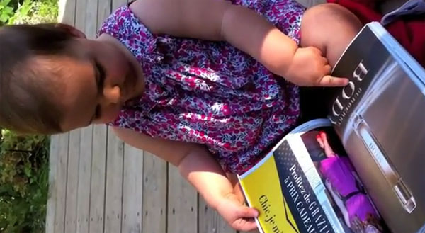 Baby tries to use print mag like an iPad, is this the death of print mags?