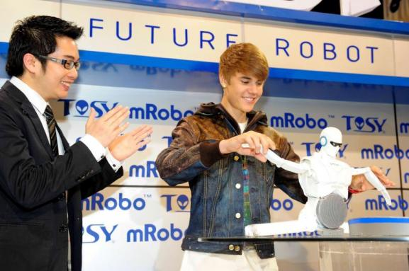 Justin Bieber unveils TOSY mRobo dancing robot at CES 2012