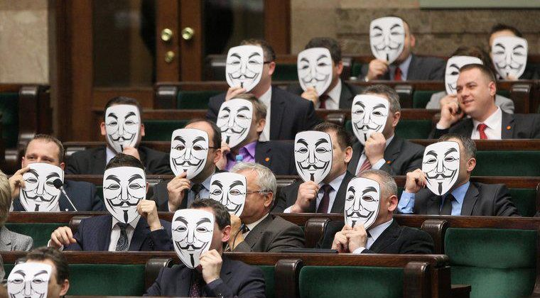Poland's politicians don Anonymous-style Guy Fawkes masks in anti-piracy protest