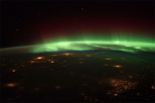 ISS astronauts snap pics of aurora borealis from space