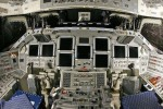 Space shuttle Endeavor flight deck is festooned with buttons