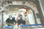 "Space Station crew savors ""new car smell"" of Dragon capsule"