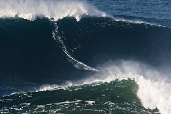 Pro surfer lands world record for riding 78-foot monster wave