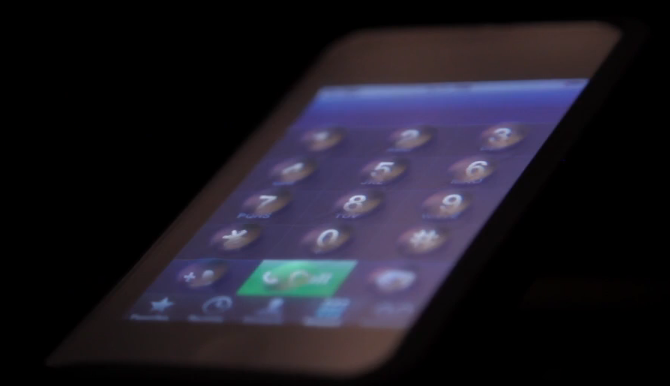 Tactus touchscreen display forms physical buttons on demand
