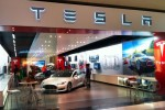 Automotive dealers associations file suit against Tesla
