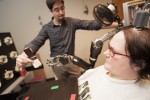 Quadriplegic uses mind-controlled robotic arm to eat chocolate bar