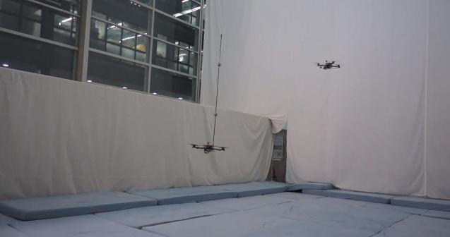 Quadrocopters perform impressive pole acrobatic stunts