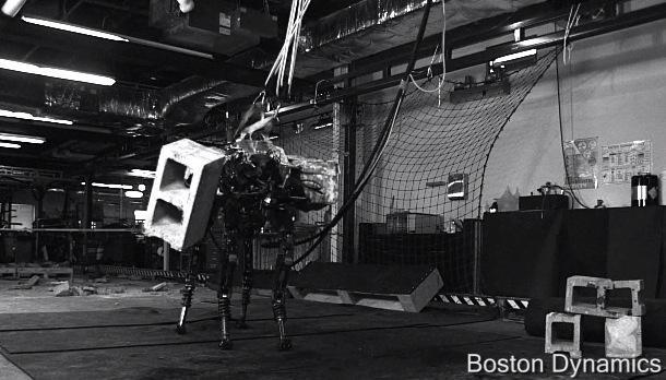 DARPA's BigDog robot can throw cinder blocks farther than you