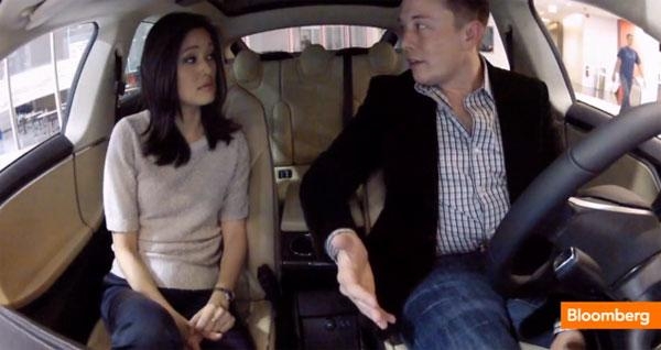 """Elon Musk shows off """"any song, any time"""" Easter Egg in Tesla's Model S"""