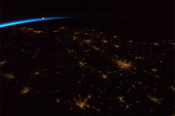 New photo from ISS shows moon rising over a darkened Earth