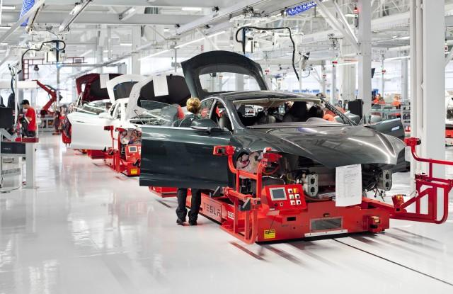"Tesla becomes ""only American car company to have fully repaid the government"""