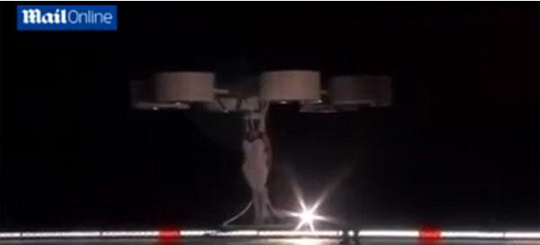 Lady Gaga hovers around the stage in the world's first flying dress