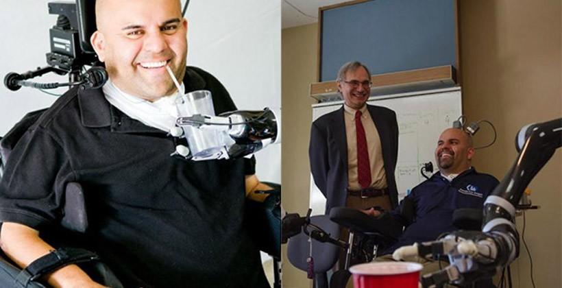 Brain controlled robotic arm lets paralyzed man drink