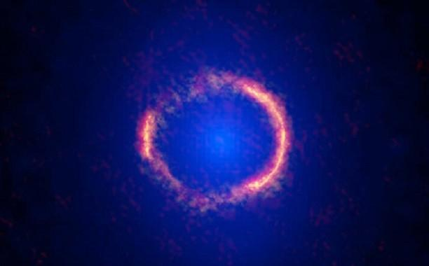 Einstein ring holds gargantuan galaxy at the edge of the Universe