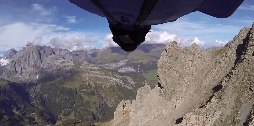Man flies through tiny mountain crevasse wearing wingsuit