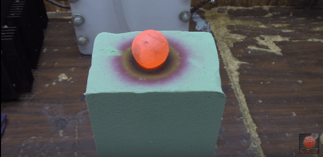 Red hot nickel ball sends foam block into color chaos