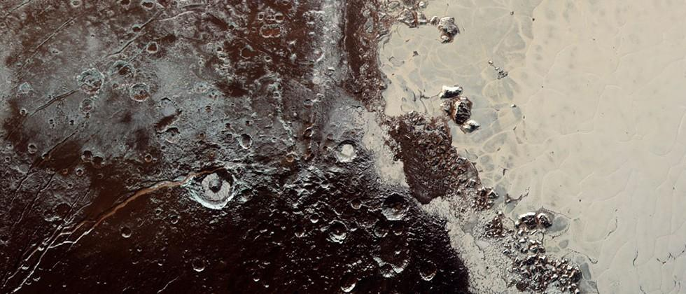 "New Pluto photos are strangest yet: ""Snakeskin"" topography"