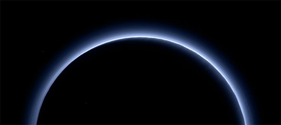 Pluto's sky and ice revealed: blue and red