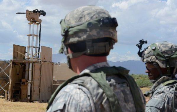 Military testing towers with remote-controlled weapons