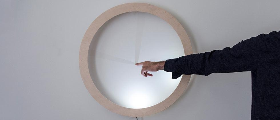 This clock needs your finger to touch it