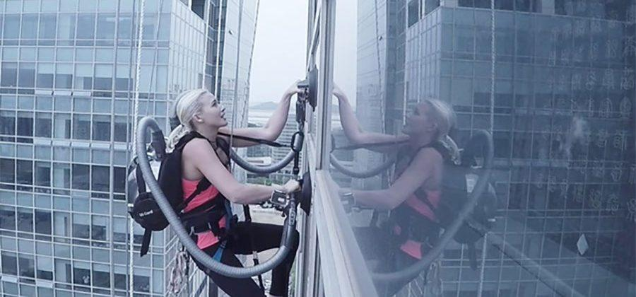 Climber scales 140m building using suction from an LG vacuum cleaner