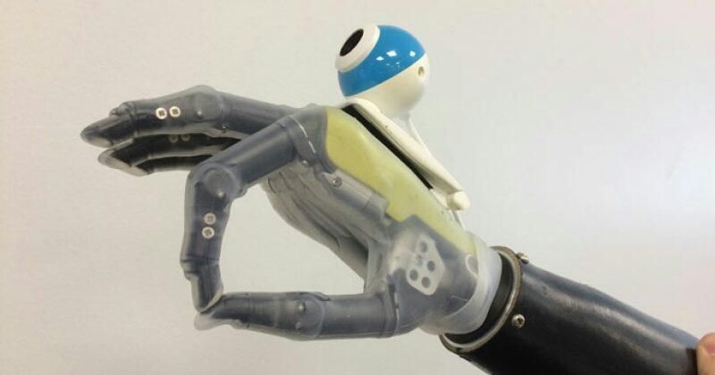 Bionic hand sees, instinctively reaches for objects