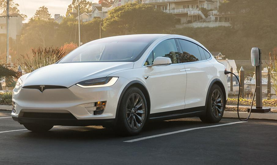 Tesla offers free charging stations for workplace parking lots