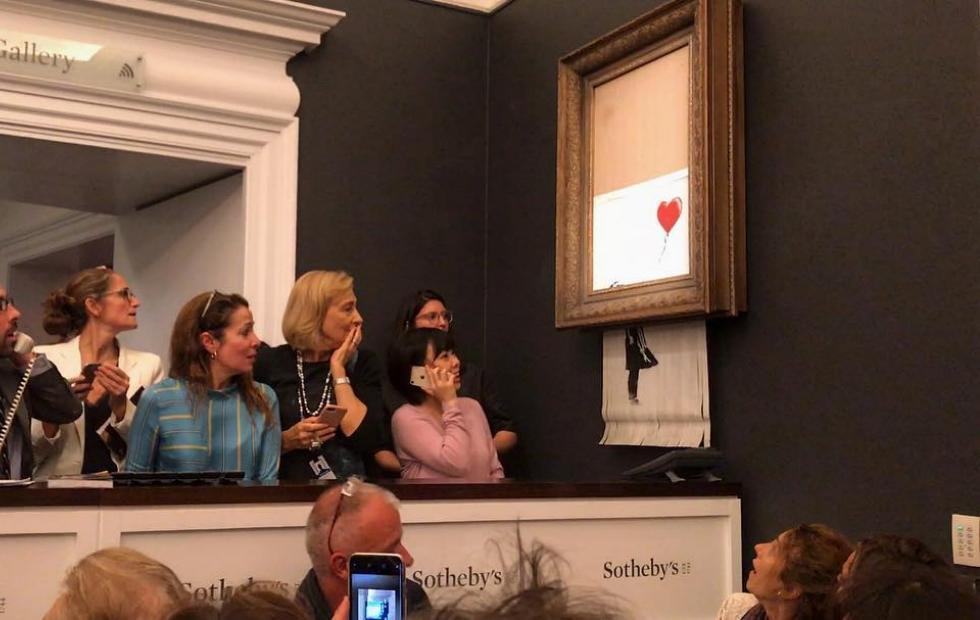 Banksy painting shredded itself after $1.4 million auction