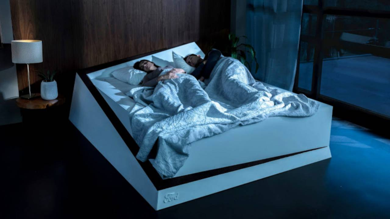 Ford smart bed rolls sleepers back to their own side of the mattress