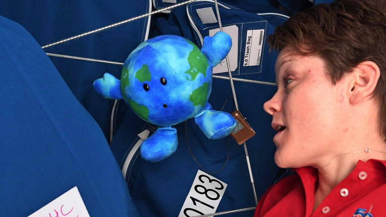 Who sent the plush Earth toy to the International Space Station?