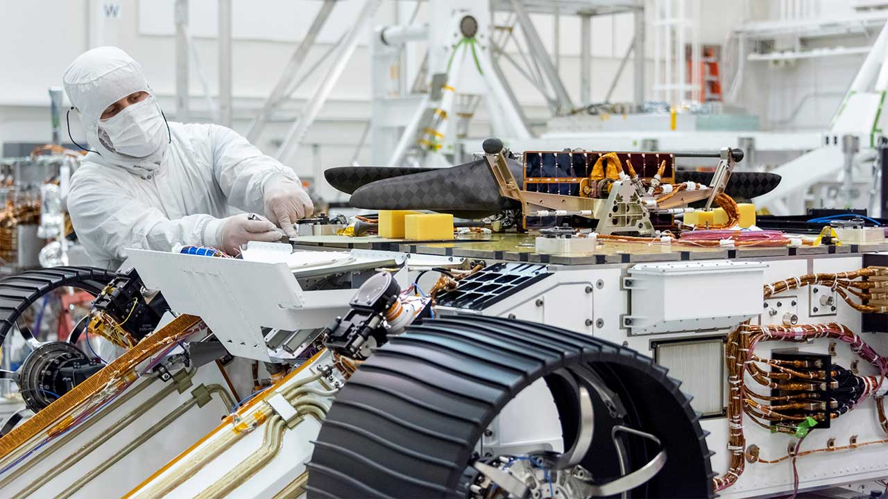 Engineers attach NASA Mars Helicopter to Mars 2020 Rover