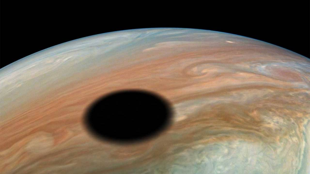 NASA image shows off volcanic moon Io casting a shadow on Jupiter