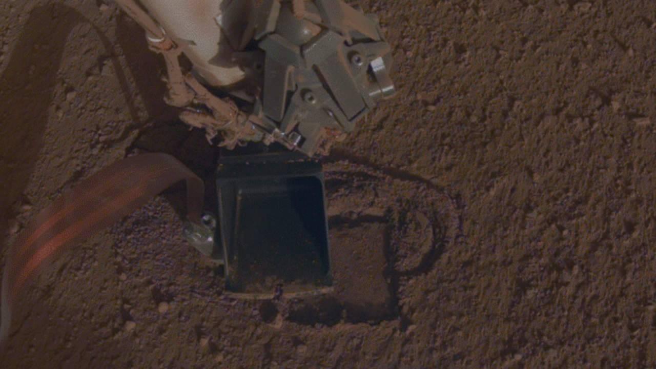 NASA InSight rover digs its 'mole' into the dusty Mars landscape