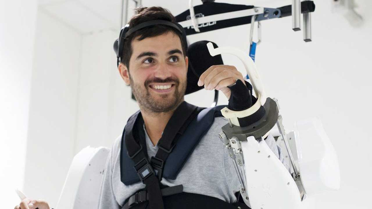 Mind-controlled robot exoskeleton allows a paralyzed man to move