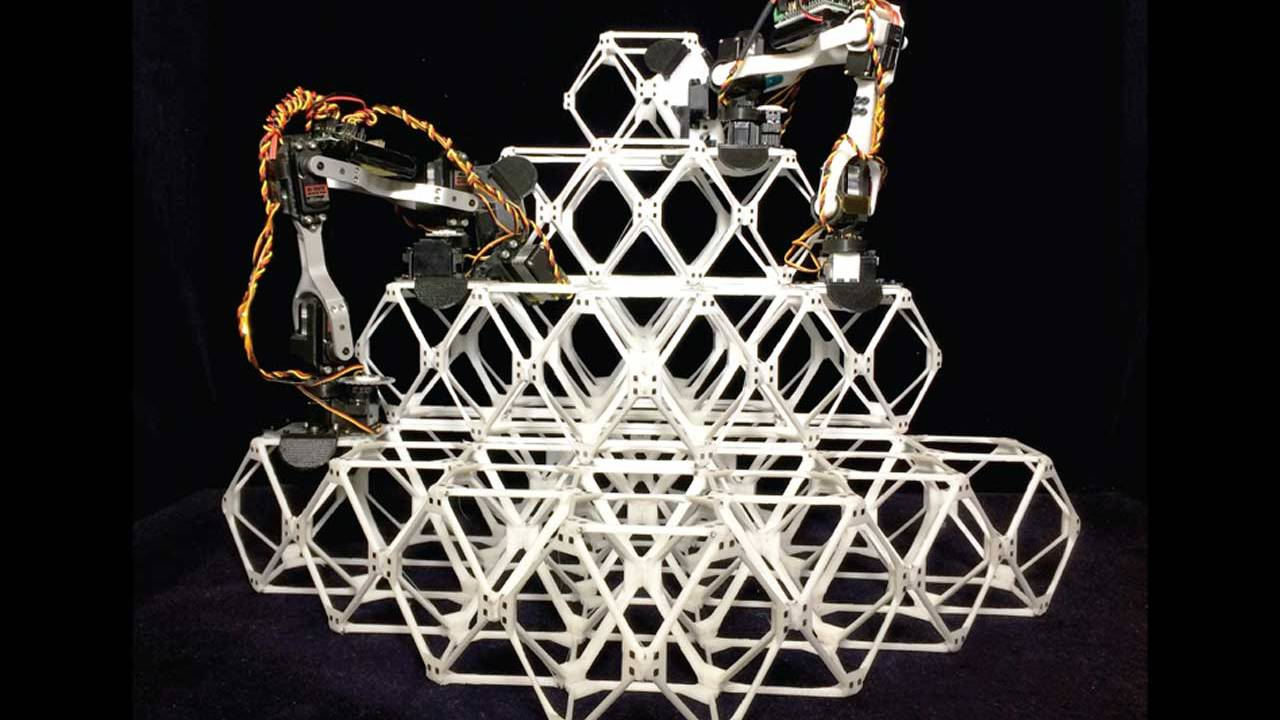 Assembler robots build large structures out of small pieces
