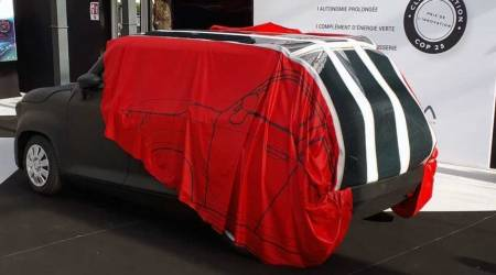 The Gazelle EV has a retractable car cover with integrated solar panels