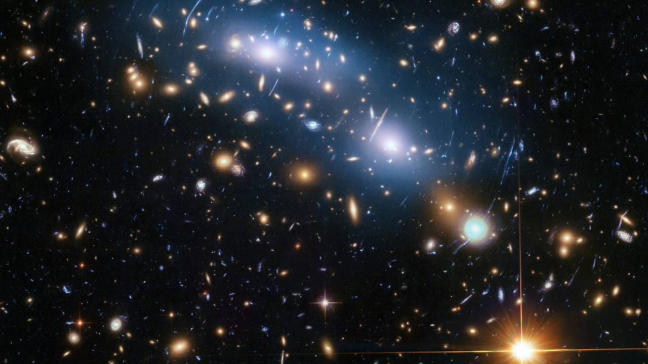 Peering deep into the early Universe, Hubble sought stars but found a mystery
