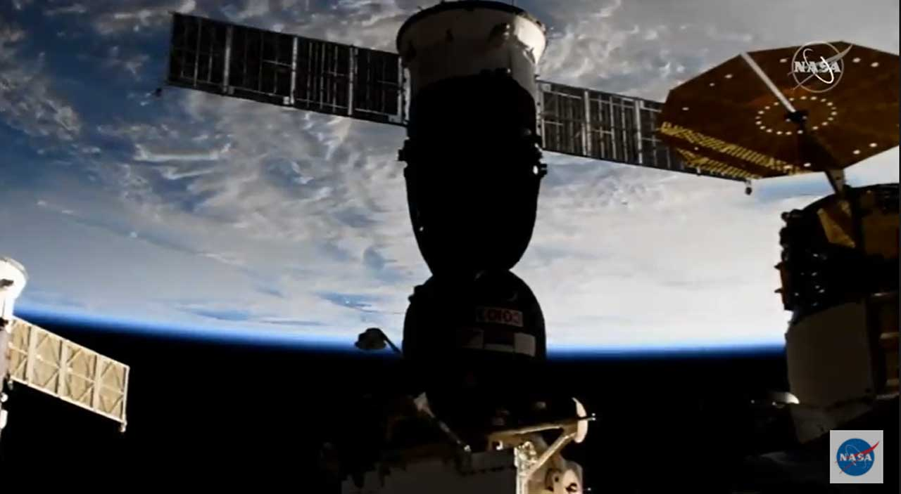 Soyuz capsule docks with the ISS delivering new crewmembers